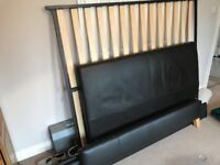 Dark chocolate leather king sized bed