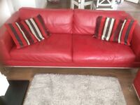 Red leather sofas 3 seater and 2 seater. Excellent condition.