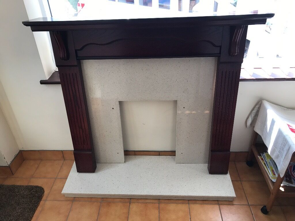 dark wood fireplace surround with nice quality sandstone marble