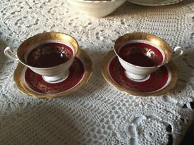 Vintage tea cup and saucer - pair dating from 1940 s . Excellent condition red with gold detail.