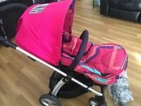 Mamas & Papas Sola swivel pushchair and footmuff - pink multi