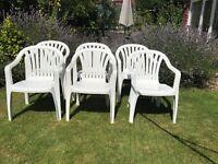 Set of 6 white plastic garden chairs