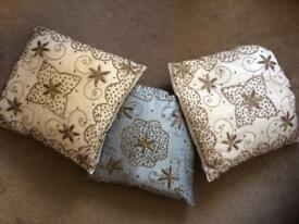 3 intricate cushions