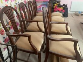 large mahogany dinning table and 8 chairs excellent condition