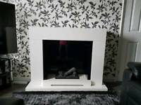 Electric fire and surround less than 6 month old