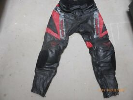 Quality Motorbike leather trousers by Schoeller. Black with red/silver detail. Very good condition.