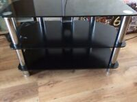 Black and silver glass television stand