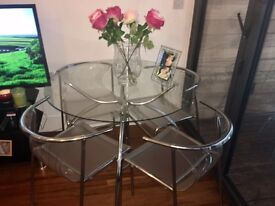 Glass dinning table 4 chairs