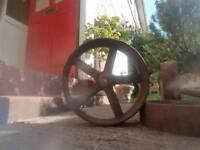 3 Cast iron wheels plus two axles.