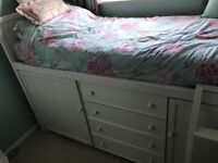 For sale solid wood childrens bed with storage underneath.