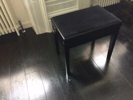 Piano stool. black polished legs