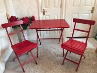 Red table and two chairs - perfect for indoor or outdoor
