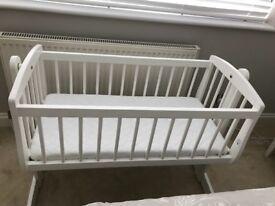 White wooden baby crib with mattress