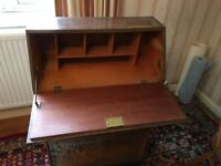 Solid wood writing desk with drop leaf and drawer.