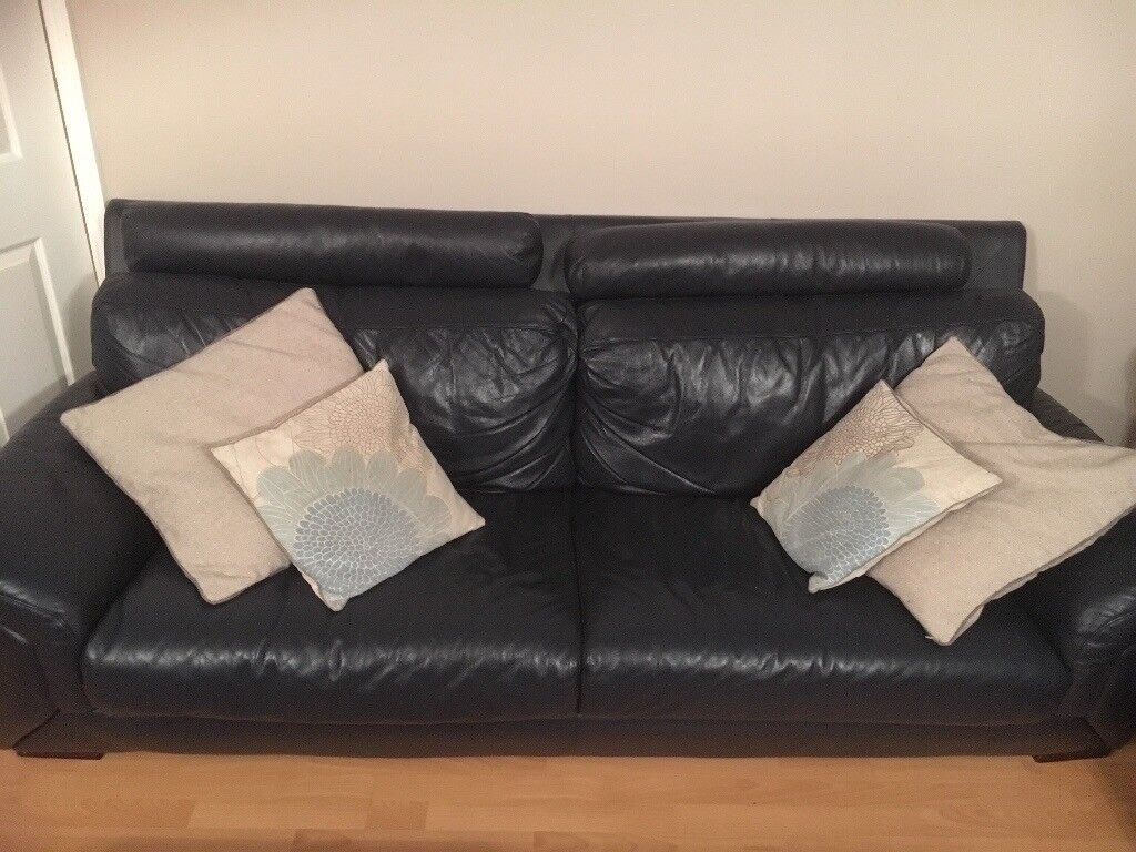 2 Blue Leather 3 seater sofas and matching footstool (with storage) very good condition.