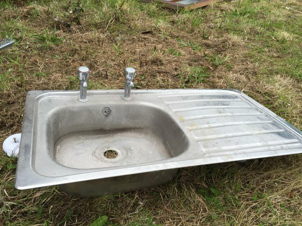 Old stainless steel sink with taps, removed from old property