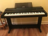 Kawai Digital Piano on stand with pedals, includes stool. 76 weighted keys. Very good condition.