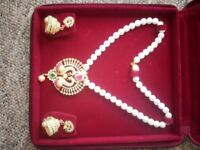 Genuine world class Pearls set and Gold plated big Pendent with Ear rings