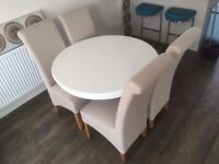 Excellent cond. Round Table and scroll back chairs.