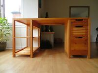 Large, solid wooden desk with underneath shelving and drawers