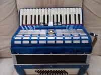 Parrot accordion 34 treble,48 bass, 5 registers. very good condition.