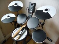 Roland TD-1KV drum kit, stool, sticks and headphones.
