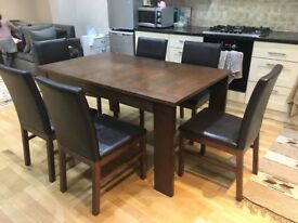 Extendable dining table for sale with 6 chairs
