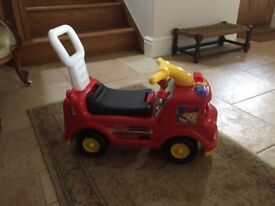 Toddler sit on fireman truck with lift up seat for storing toys etc