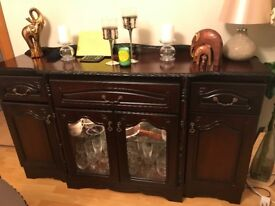 Large dark wood dining room chest and matching glass/ ornament cabinet