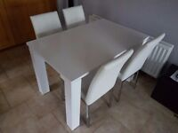 4 ft White gloss dining table and 4 white leather dining chairs
