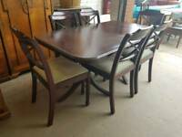 Large brown dining table with 6 chairs