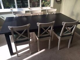 Brown-Black extendable dining table with 6 chairs