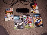 SONY PSP WITH CHARGER AND GAMES AND FILM