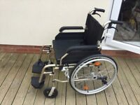 Self propelled wheelchair.