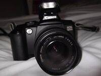 canon EOS slr camera fitted with canon 38-76 mm auto/manual focus lens