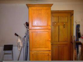 Oak finish storage cupboard for sale.