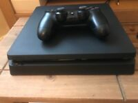 PlayStation 4 with wireless pad and 2 games