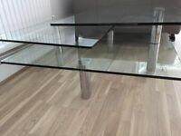 Rotating glass coffee table