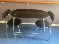 BLACK & SILVER GLASS BREAKFAST TABLE + 2 CHAIRS IN GOOD CONDITION FREE DELIVERY
