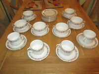 CHINA SET of SIX SOUP BOWLS and MATCHING SAUCERS, TWELVE SIDE PLATESa and FOUR CUPS and SAUCERS