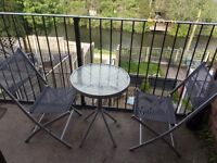 Glass patio table and 2 folding chairs