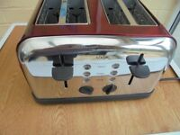 red metalic four slice toaster new in box