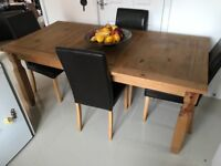 Solid wood large dining table & 4 chocolate high backed chairs