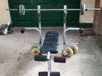 Bench press and box of weights