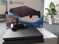 ps4 practically brand new only played on for one hour comes with Resident Evil game