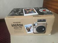Instax mini 70 in stardust gold for sale.
