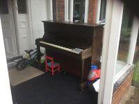 Brendorf upright piano.