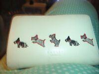 radley cream coloured leather radley purse . USED