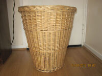 A wicker laundry basket , £5.