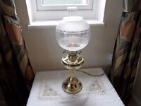 BRASS ELECTRIC OIL LAMP IN V.G.C. WITH GLOBE AND CHIMNEY.